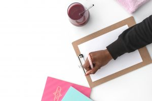 How Pinterest helps in growing business header photo - woman writing a list